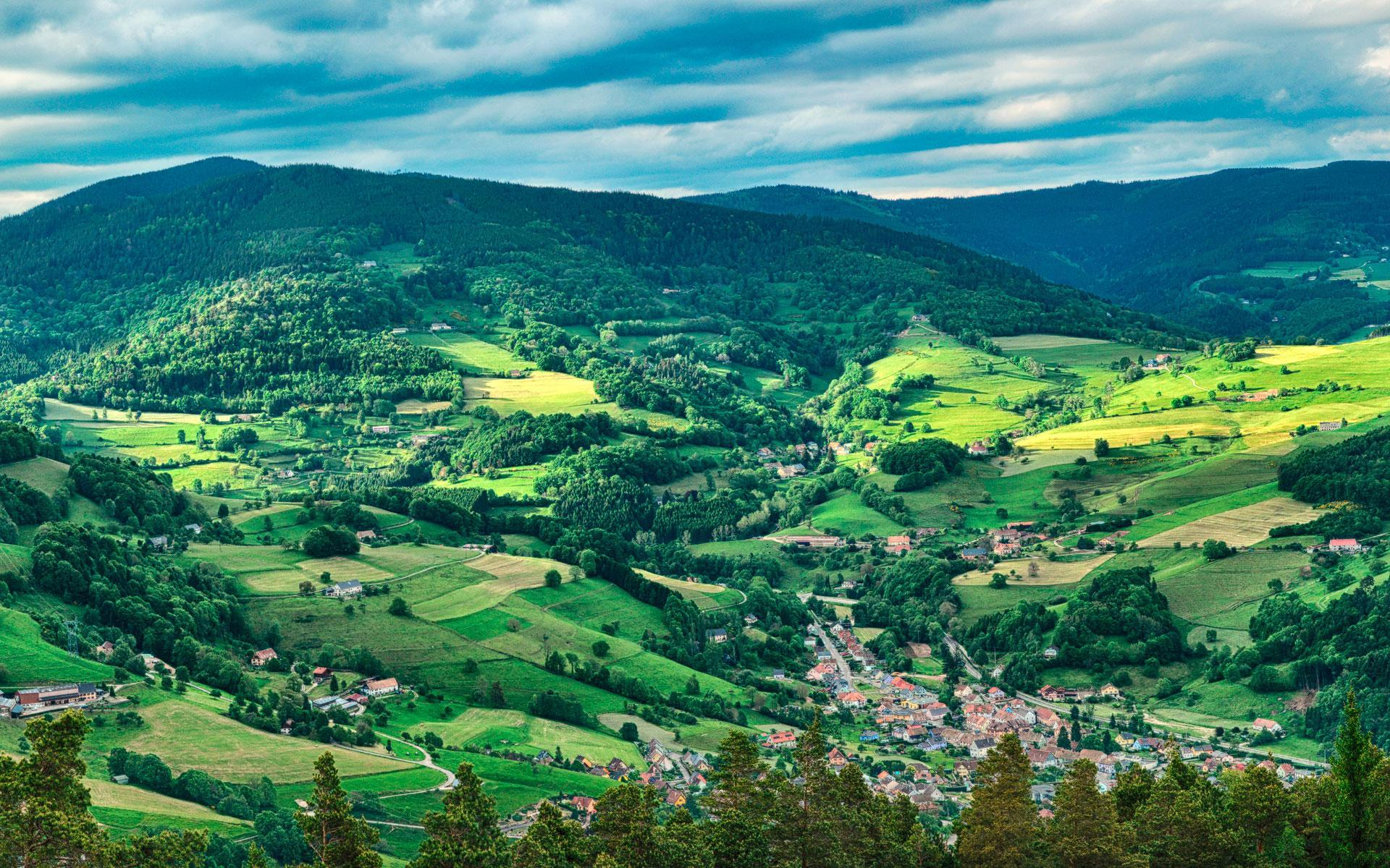 Panoramic photography of the green Munster Valley, in the heart of the Vosges